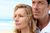 Headshot of couple by sea — Stock Photo