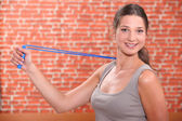 Woman using an arm extender — Stock Photo