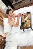 Man having breakfast in bed — Stock Photo