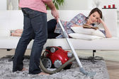 Man using vacuum cleaner — Stock Photo