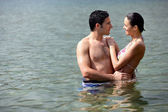 Couple embracing in the water — Stock Photo