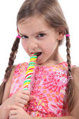 Girl eating a lolly pop — Stock Photo