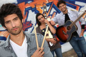 A group of musicians busking on the streets — Stock Photo