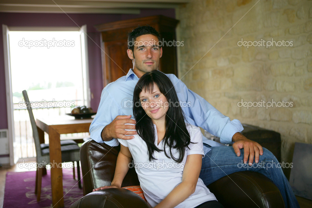Couple on a sofa — Stock Photo #9040928