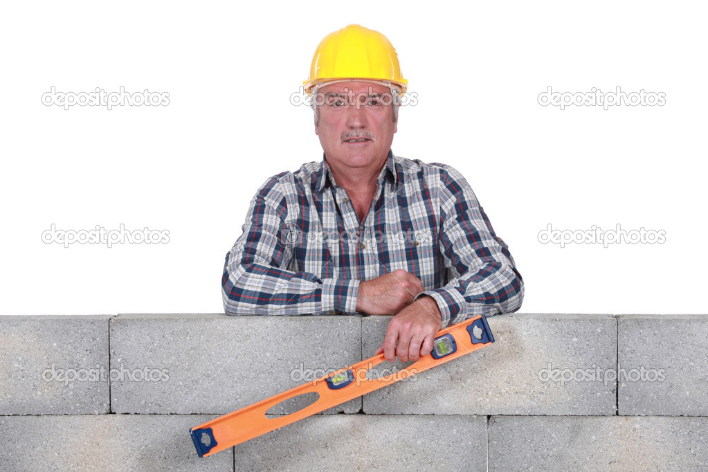 Stonemason holding a bubble level  Stock Photo #9041143