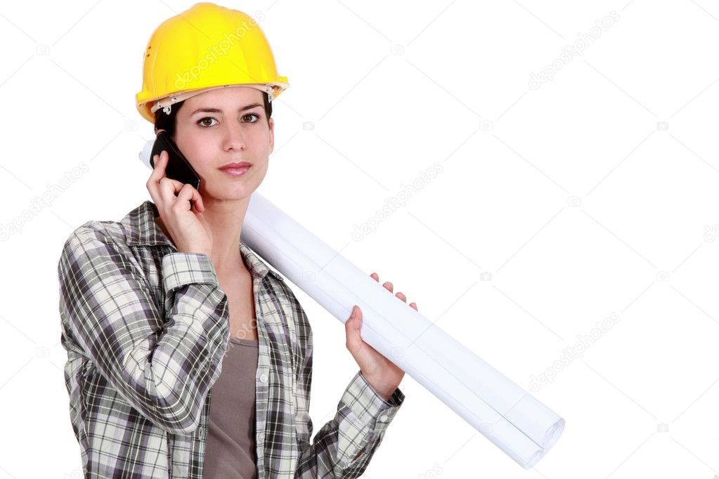 Female foreman with plans and mobile — Stock Photo #9042757
