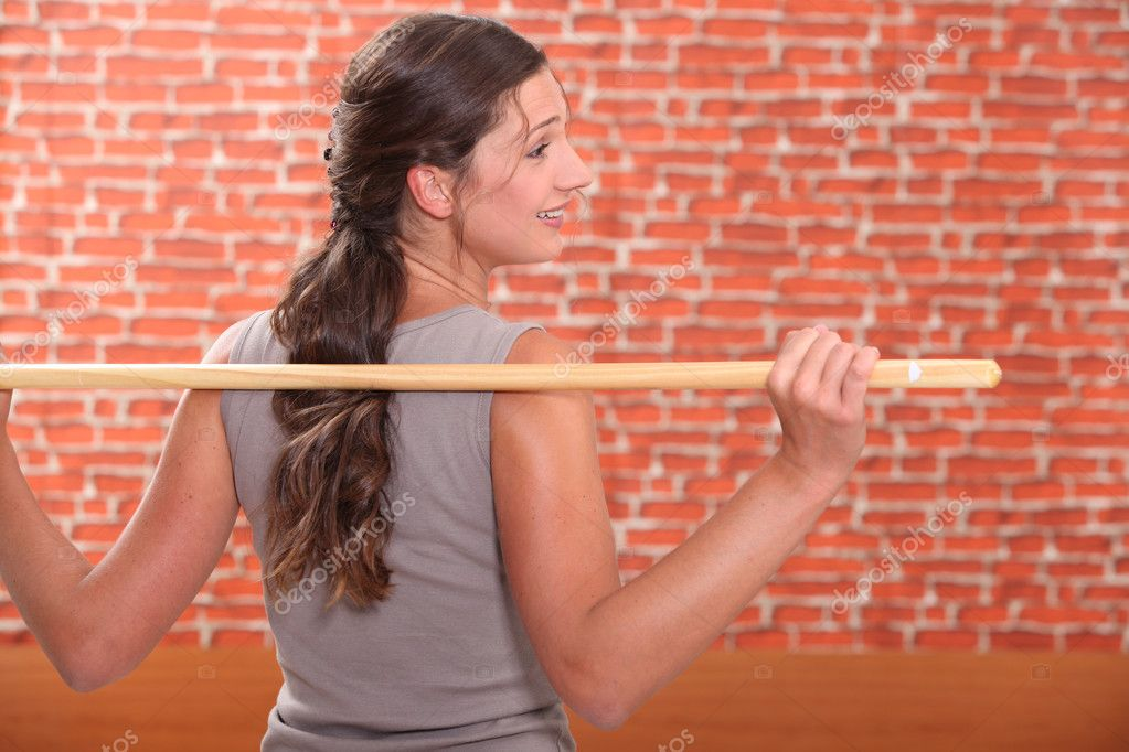 Woman exercising with a stick — Stock Photo #9049854