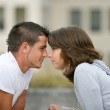 Young couple face to face — Stock Photo #9050053