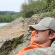 Stock Photo: Msleeping on banks of river