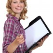 Stock Photo: Blond secretary holding folder and pen