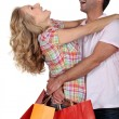 An elated couple embracing — Stock Photo
