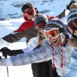 Stock Photo: Friends on ski slopes