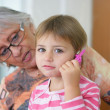 Grandmother playing with a child — Stock Photo