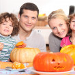 Stock Photo: Carving Halloween pumpkin