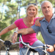 Couple enjoying a bike ride - Stock Photo