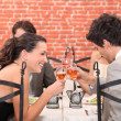 Happy couple drinking wine in a restaurant — Stock Photo
