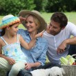 Family outdoors with their dog — Stock Photo
