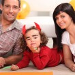 Little girl dressed as devil