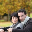 Couple on an autumn stroll — Stock Photo #9052414