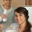 Woman eating cereal for breakfast — Stock Photo #9053192