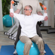 Stock Photo: Elderly womwith personal trainer