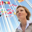 Stock Photo: Businesswomwith flags.