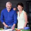Stock Photo: Elderly couple preparing a meal