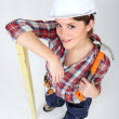 Female carpenter with a hammer — Stock Photo