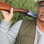 Hunter with a shotgun — Stock Photo