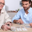 Mother and son playing cards — Stock Photo