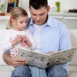 Father reading a book to his little girl — Stock Photo #9057415