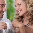 Closeup of couple drinking champagne and looking into each others' eye - Foto Stock