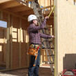 Stock Photo: Contractor inspecting woodwork on house under construction