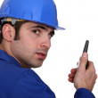 Builder using a walky talky — Stock Photo