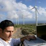 Man stood by wind farm taking readings — Stock Photo #9057994