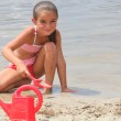 Little girl digging on the beach — Stock Photo #9058885