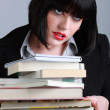 A woman holding a stack of books — Stock Photo