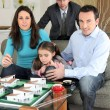 Architect with a family looking at a construction model — Stock Photo