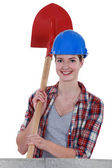 Young craftswoman holding a shovel — Stock Photo