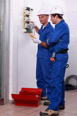 Two electricians checking power supply — Stock Photo