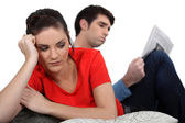 Bored couple sat at home — Stock Photo