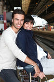 Couple waiting for the train — Stock Photo