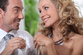 Closeup of couple drinking champagne and looking into each others' eye — Stock Photo