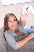 Teenager with video game command — Stock Photo