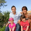 Happy family gathered in the back garden — Stock Photo