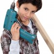 Stock Photo: Young boy pretending to be tradesman