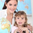 Little girl and her teacher posing together — Stock Photo #9060740