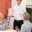 Senior couple dining in restaurant - Stock Photo