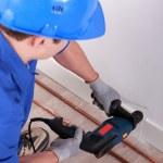 Plumber drilling — Stock Photo