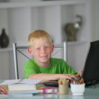 Little boy doing his homework in the kitchen — Stock Photo